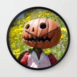 Jack Pumpkinhead in yellow field Wall Clock
