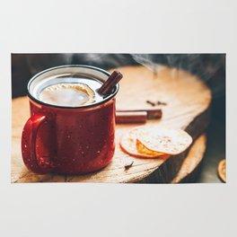 Mulled wine in a red ceramic mug Rug