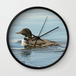 Baby on moms back Wall Clock