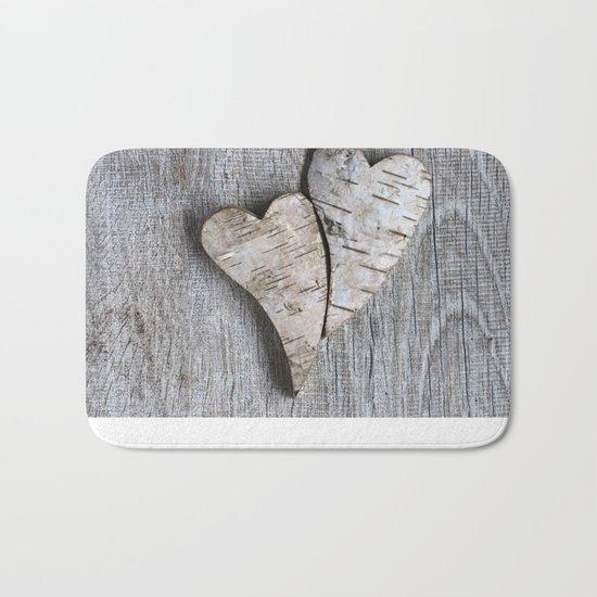 two wooden hearts love symbol Bath Mat