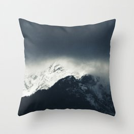 Darkness and light on snow covered mountains Throw Pillow