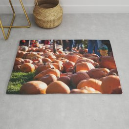 Pumpkins on a farm in the fall during harvest time Rug
