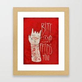 bite the hand. Framed Art Print