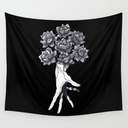 Hand with lotuses on black Wall Tapestry