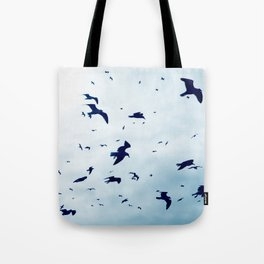 Free - Seagulls fly high up in the sky. Tote Bag