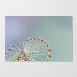 Ferris wheel against a blue sky with vintage film simulation Canvas Print