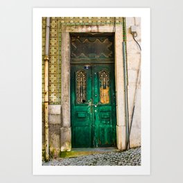 Old wooden door secured with chain and padlock. Wall with profusely decorated tiles. Art Print