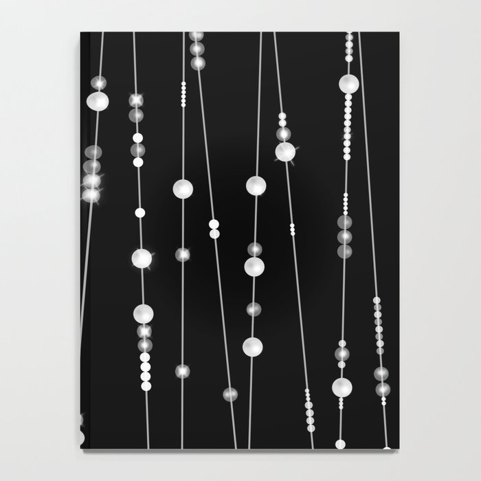 . Pearl beads on a black background Notebook