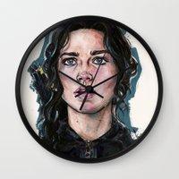 katniss Wall Clocks featuring Katniss Everdeen by vooce & kat
