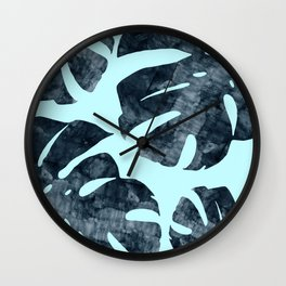 Tropical leaves on blue background Wall Clock