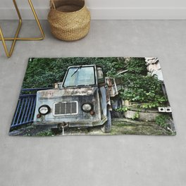 Abandoned and rusted truck Rug