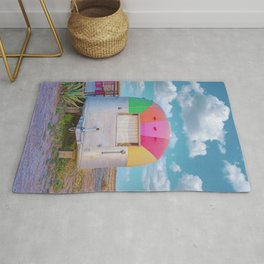 Vintage Camping Trailer with a Rainbow Top in Marfa, Texas Rug