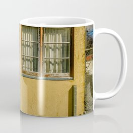 Orange industrial unit with peeling paint. Coffee Mug