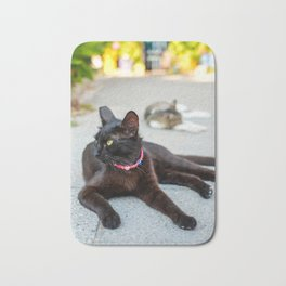 black cat in Santorini island, Oia, Greece Bath Mat