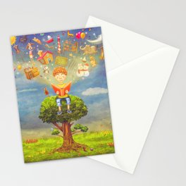 Little boy sitting on the tree and  reading a book, objects flying out Stationery Cards