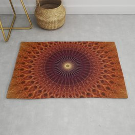 Mandala in orange and brown colors Rug