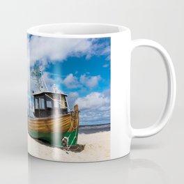 Fishing boat on the beach Coffee Mug