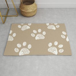 Light brown colored paw print pattern background Rug