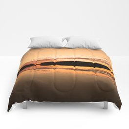 Beautiful sunset - glowing orange - forest silhouette and reflection Comforters