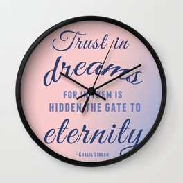 Trust in dreams, for in them is hidden the gate to eternity Wall Clock