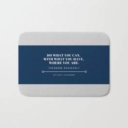 """Theodore Roosevelt Quote """"Do what you can, with what you have, where you are."""" Bath Mat"""