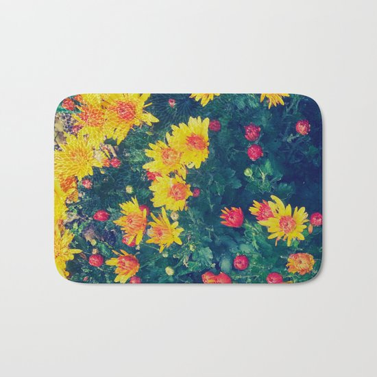 Vibrant floral blossoming in yellow, green, blue and red Bath Mat