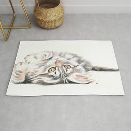 Cute Maine Coon Kitten Playing Rug