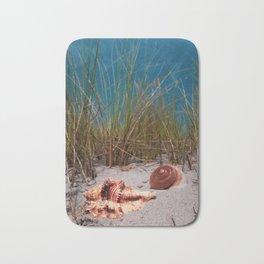 Big shells in the sand Bath Mat