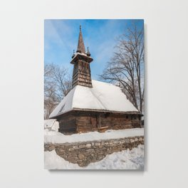 Traditional rural wooden church covered in snow Metal Print