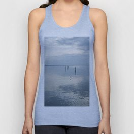 A blue lagoon and the water reflections Unisex Tank Top