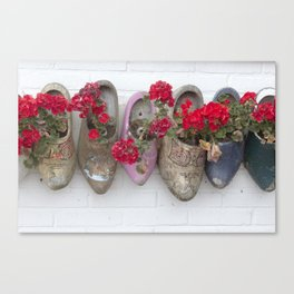 Dutch wooden shoes and geraniums from Marken, Holland Canvas Print
