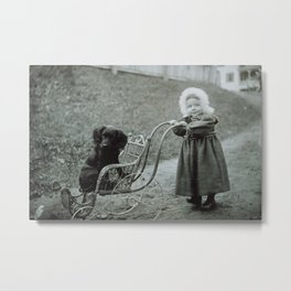Child pushing her pet dog in a baby carriage Metal Print