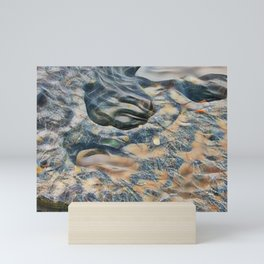 Abstract eroded rocks on beach with puddle Mini Art Print