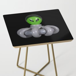 Green Balloon Animal Alien in Gray Spaceship on Black Side Table