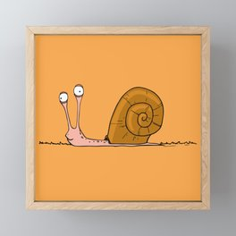 Funny snail with silly face expression Framed Mini Art Print