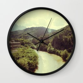 Between Mountains  Wall Clock