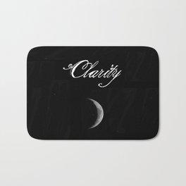 A Crescent-Shaped Clarity Bath Mat