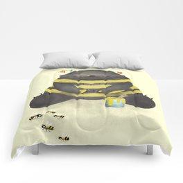 Dark chocolate bear imitating a bee on vanilla background Comforters