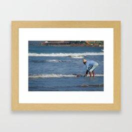 Cleaning Buckets in the Sea Arambol Framed Art Print