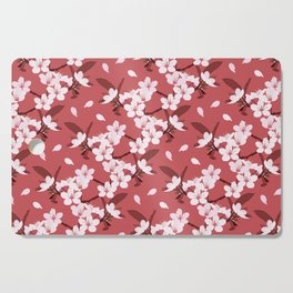 Sakura on red background Cutting Board