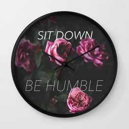 sit down be humble in roses Wall Clock