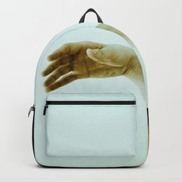 reaching out. Backpack