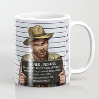 indiana jones Mugs featuring Indiana Jones Mugshot by The Cracked Dispensary