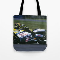 honda Tote Bags featuring VALENTINO ROSSI RIDING A HONDA by Don Hooper
