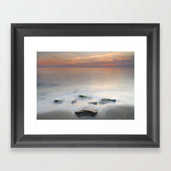 Calm red sunset at the beach Framed Art Print