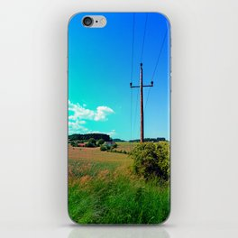 Clouds, a powerline and lots of green iPhone Skin