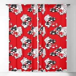 Playing Cards and Casino Chips on Red Blackout Curtain