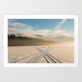 Crossing tracks on snow covered frozen lake Art Print