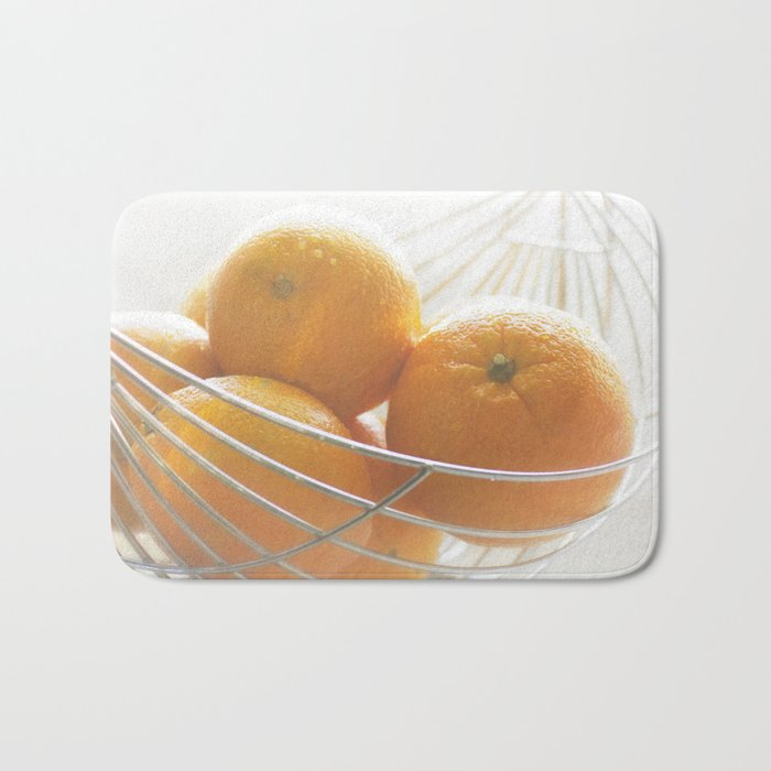 Fresh oranges in basket Bath Mat