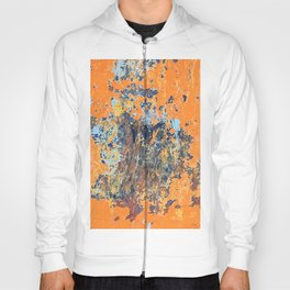 Orange metal background with cracked, peeling paint with stains of blue paint and rust spots. Hoody